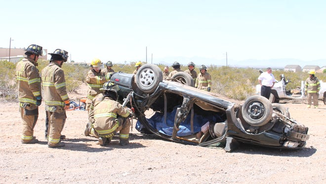 Alamogordo firefighters are cutting off the roof of a vehicle during a training exercise.