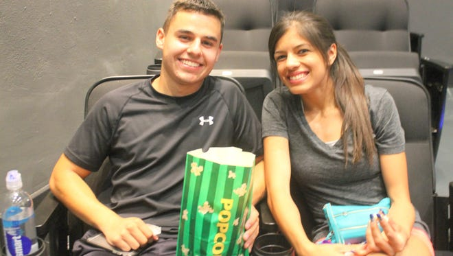 Silver High students Gabriel Gomez and Gabby Maynes wait for the movie to start at the grand opening of the Silco Theater.
