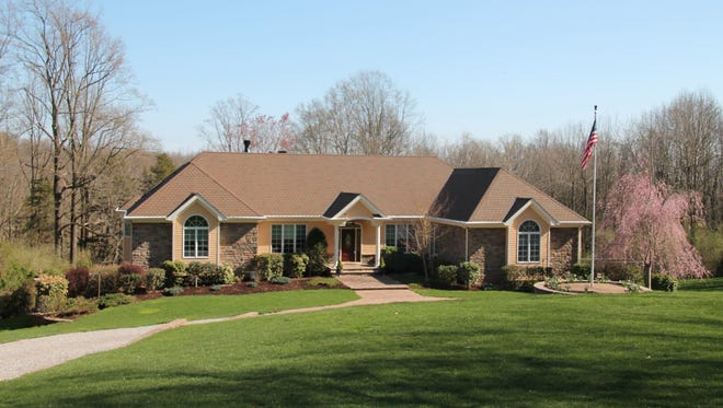 This custom-built ranch in Alexandria has more than 6,200 square feet and 9 private acres.