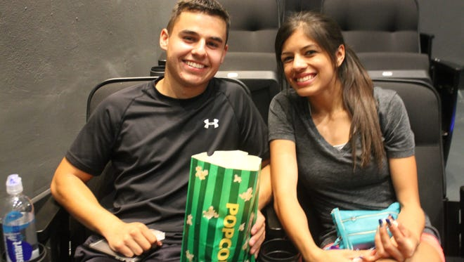 Silver High School students, Gabby Maynes and Gabriel Gomez wait for the movie to start at the grand opening for the historic Silco Theater on Saturday, April 21.