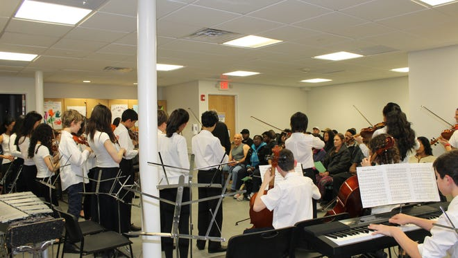 Students from Scarsdale Middle School perform for Lifting Up Westchester Clients at the Open Arms Shelter in White Plains.
