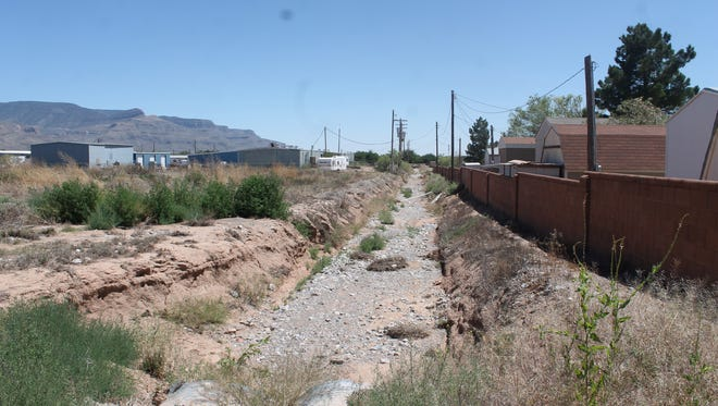 A channel from Dry Canyon cuts through the Oasis Mobile Home Park. City Commissioners approved the purchase of the land to the left of the channel in an effort to fix flooding issues.
