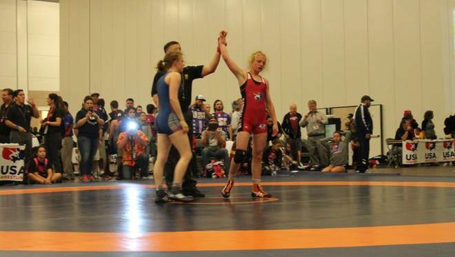 Stratford freshman Macey Kilty, right, recently qualified for the USA World team in girls freestyle wrestling.