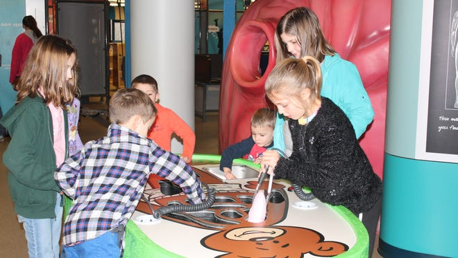 Buddy the Bear Clinic at Children's Museum allows kids to play doctor
