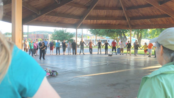 Community members stood in a circle of remembrance and love for the victims of the June 12 shooting in Orlando, Fla.