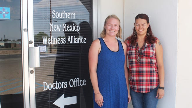 Sexual assault nurse examiner Sarah Abner and SANE director Staci Guerrero stand in front of the SANE office located at 1410 Aspen Road.