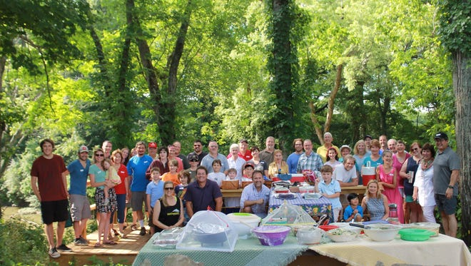 Gardeners from the Stewards Garden at Christ Community Church celebrate their harvest with a summer picnic hosted on the church grounds near the garden.