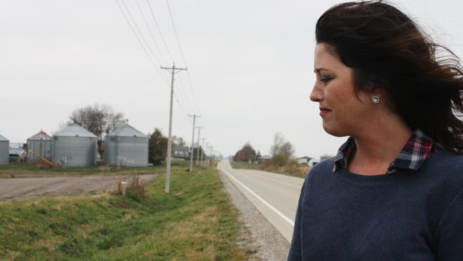 Laura Maurer of Brooklyn, Iowa, looks on with anguish at the scene of the 2014 fatal accident she caused by reading a text message.