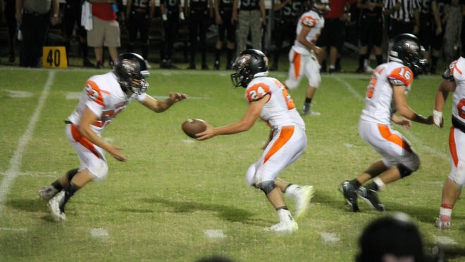 The Capitan Tigers are seen here playing for the win over New Mexico Military Institute Friday in Roswell.