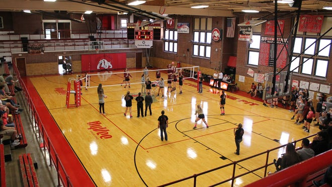 Volleyball players warm up for a match at James Ball Gymnasium at Central High School on Oct. 11, 2016.