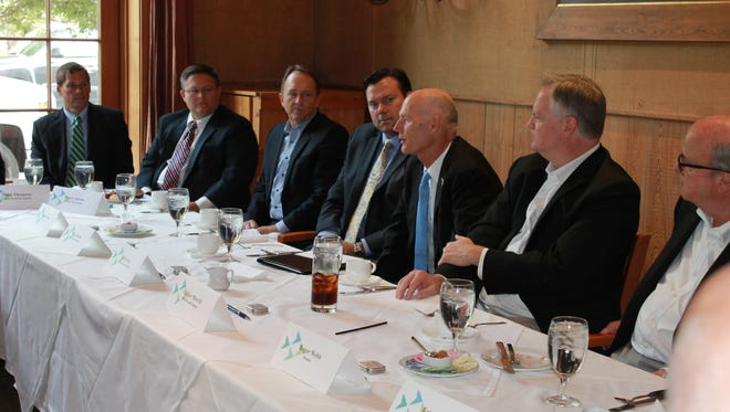 Gov. Rick Scott met with small business owners at a private event hosted at Jackson's Steakhouse Friday morning