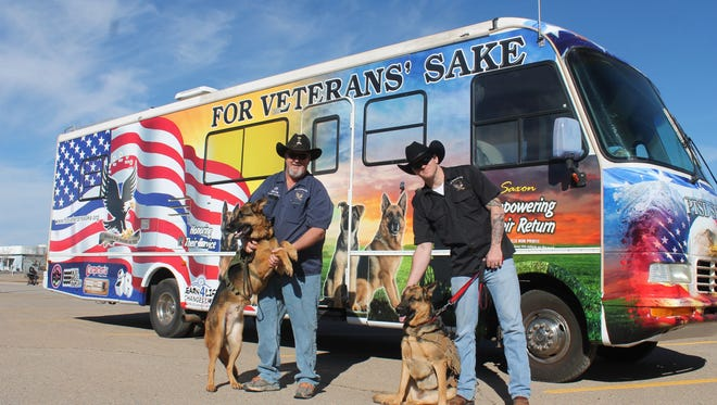 Bear, For Veterans' Sake President Monty Hutson, Lilly and Jonathan Harper stand in front of their outreach RV.