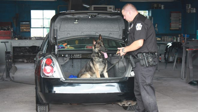 In this submitted file photo, Rony, the Greencastle Police Department K-9, conducts a vehicle search.