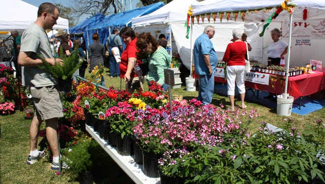 Festival-goers to the Louisiana Nursery Festival in Forest Hill look over plants and crafts available at the event.