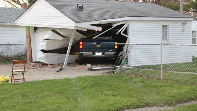 Police say a man drove his truck into this garage Wednesday night in Livonia. Alcohol is believed to be a factor.