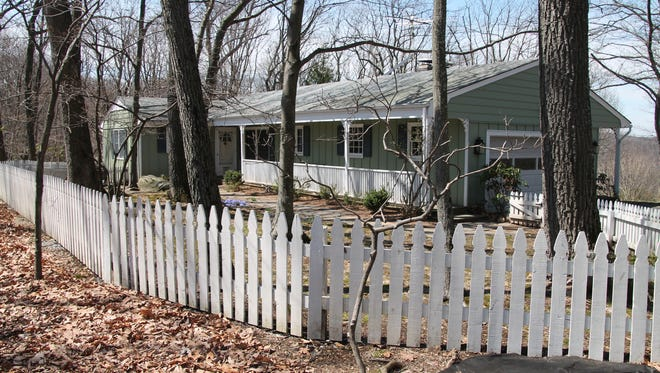 This home has three wooded acres, with a fenced front yard to keep pets and children safe.
