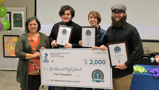 Burkburnett High School went home with the first-place prize in a Better Business Bureau, North Central Texas, video contest. Pictured are teacher Melinda Kleckner and students Ryan Caporale, John Puentes and Randy Blackmon.
