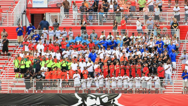Hundreds of basketball players pack APSU's Fortera Stadium in Clarksville during the 2015 AAU Boys National Basketball Championship Opening Ceremonies.