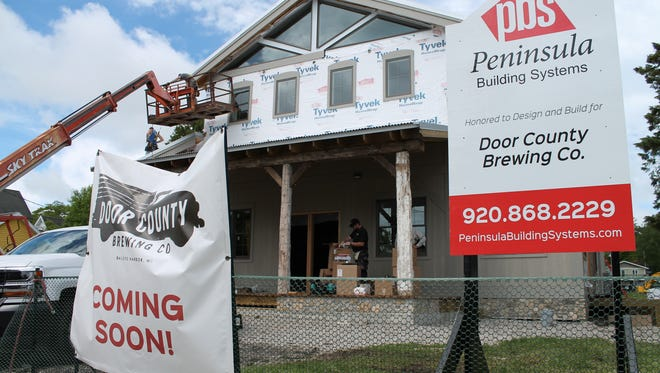 Siding was still being put in place as of June 19 as Door County Brewing prepared to open its new taproom Saturday in Baileys Harbor.
