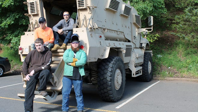Clockwise: Skylar Holland of Raritan, Bane Tindall of Manville, Logan Dolci of Hillsborough, and Timothy Cho of Bridgewater in front of the MRAP.