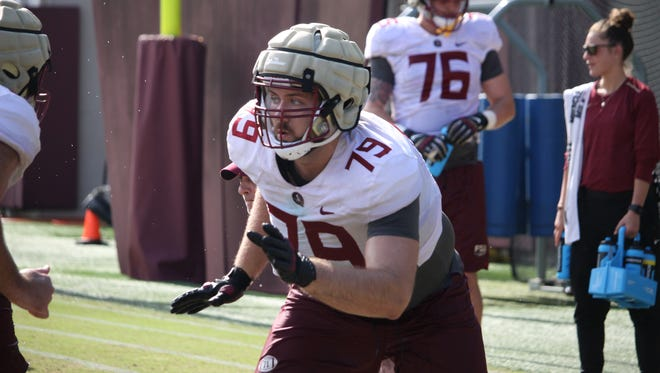 FSU OL Josh Ball blocking during a drill.