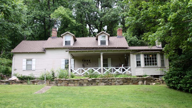 This nineteenth-century farmhouse has wide-plank-pine floors, a country kitchen, a first-floor master suite and 75.5 acres with a forestry management plan.