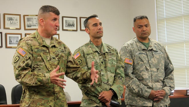 In this 2016 file photo, from left to right: Col. Tom O'Connor, Commander of the Combat Aviation Brigade, Lt. Col. Segura, G3 for Air Operations and Chief Pilot Murino, Combat Aviation Brigade presented to county commissioners their proposal to train in Lincoln National Forest to practice high altitude flying and landing.
