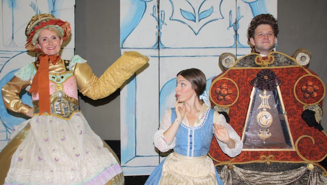 """Belle (played by Emily Cara Portune, center) receives advice from Mrs. Potts (Jenna Morris) and Cogsworth (Dennis Connors) in """"Beauty and the Beast.""""  The stage musical version of the Disney film opens tonight at The Growing Stage - the Children's Theatre of New Jersey in Netcong."""