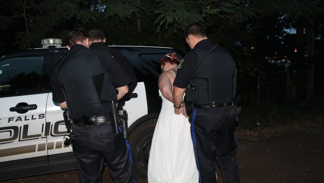 """Juaquina and Jesse Van Ommeren get """"arrested"""" during some of their wedding photos."""