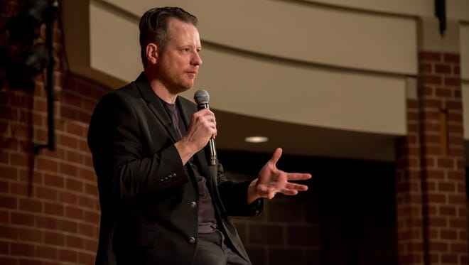 John Sparrow, the drummer for the Violent Femmes, speaks to students at South Milwaukee High School Tuesday, Oct. 3.