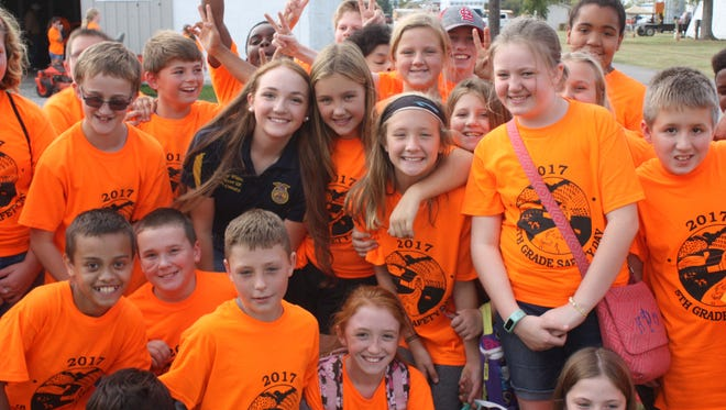Group leader- Mallory White, UCHS Sophomore, smiles  with her group of 5th grade students from Morganfield Elementary school.