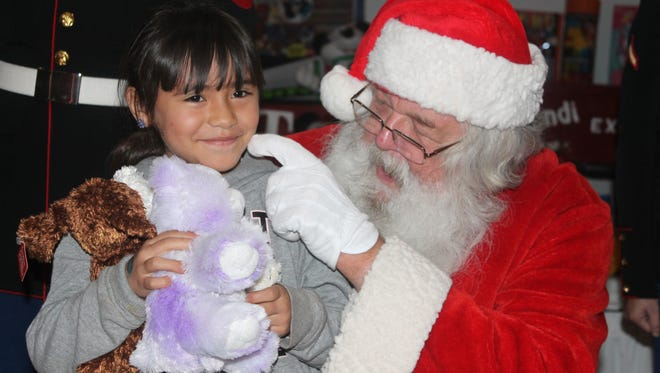In this 2015 file photo, Desire Duran sits on Santa's lap at the Otero County Toys for Tots Christmas event at the Sgt. Willie Estrada Memorial Civic Center on Christmas Eve 2015.