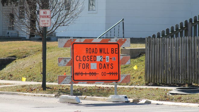 A sign warns drivers about the upcoming closure of South West 13th Street between National Road West and West Main Street.