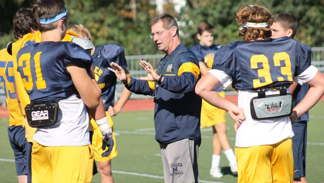 FILE -- Moeller coach John Rodenberg has kept the Crusaders in the playoff mix.