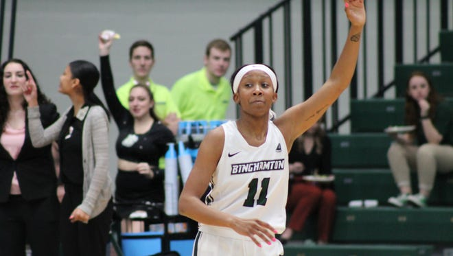 Senior Imani Watkins waves after hitting a three-pointer that made her Binghamton University's' all-time leading scorer Saturday in an America East game against UMass Lowell at the Events Center. Watkins finished with five points in the Bearcats' 52-38 victory.