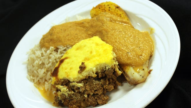 Bobotie is a South African dish with beef, ginger, chutney, bread and raisins topped with custard.