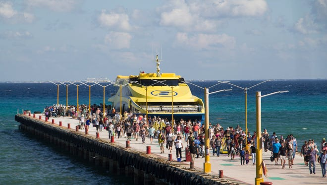 Tourists and passengers disembark from a ferry on to the wharf on Playa del Carmen on March 2. Undetonated explosives were found on another ferry that runs between the Caribbean resorts of Playa del Carmen and the island of Cozumel.