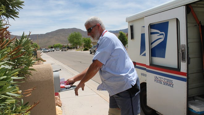 In this file photo, local US Postal worker Rich Merrick participates in the Stamp Out Hunger Food Drive. On Saturday, May 12 residents can leave bags of non-perishable food items next to their mailbox in donation to a local pantry.