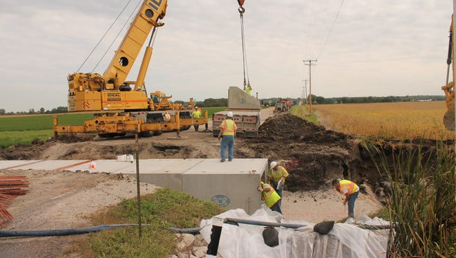 """Workers construct a box culvert on Fond du Lac County B, which previously was a """"deteroriated corrugated metal pipe,"""" according to  Thomas Janke, Fond du Lac County Highway commissioner."""