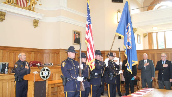 The Somerset County Sheriff's Office Honor Guard presents the colors at the historic courthouse in Somerville during a swearing-in ceremony. Sheriff Frank J. Provenzano, left at podium, leads the Pledge of Allegiance.