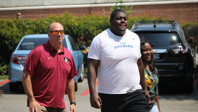 Five-star offensive guard Kardell Thomas with FSU offensive line coach Greg Frey at FSU's Saturday Night Live recruiting event in 2018.