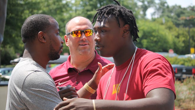 Three-star offensive tackle Charles Cross meets with FSU coaches Donte' Pimpleton and Greg Frey before FSU's Saturday Night Live recruiting event in 2018.