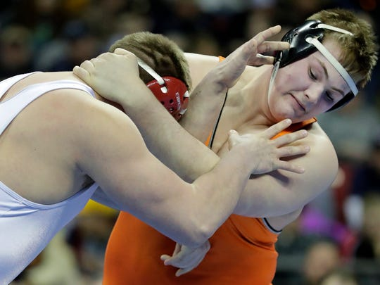 Kaukauna's Keaton Kluever, right, wrestles Pewaukee's Blaze Beltran during their 285-pound WIAA Division 1 championship wrestling match last February in Madison.