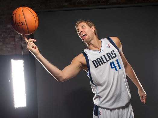 Dallas Mavericks power forward Dirk Nowitzki (41) poses for a photo during media day at the American Airlines Center.