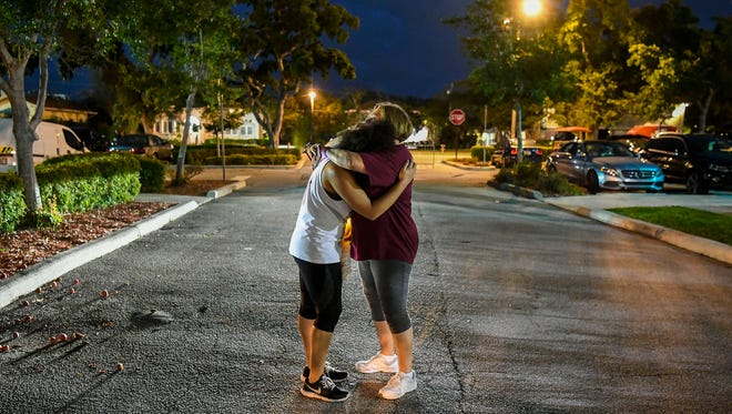 Hannah Karcinell, 18, left, a student at Marjory Stoneman Douglas High School in Parkland, Fla., hugs her mother, Jodi, after attending a rally against assault weapons.
