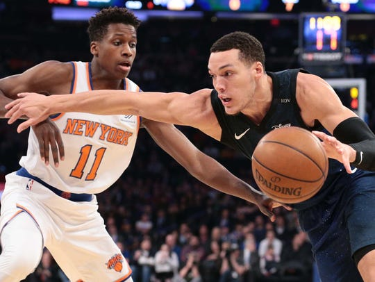 Frank Ntilikina defends Orlando Magic forward Aaron Gordon.