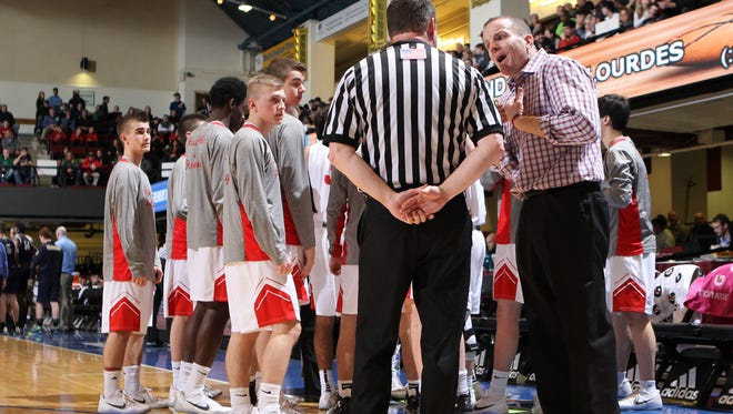 Tappan Zee head coach George Gaine questions a call with the referee during the 2017 Section 1 Class A boys championship basketball game at the Westchester County Center in White Plains.