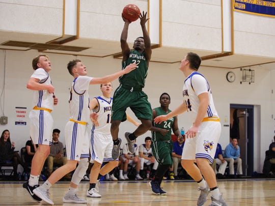 Winooski's Abdullah Sadik (22) leaps to take a shot