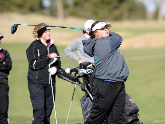 Cooper's Megan Wilcox tees off during the second round of the Region I-5A tournament at The Rawls Course in Lubbock.
