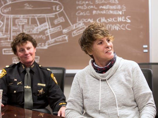 Major Charmaine McGuffey, then Commander of the Hamilton County Justice Center, left, and Tracy Brumfield, peer counselor, talk about the recovery pod at the Hamilton County Justice Center. The majority of the women in the program have opioid addiction. The program offers the women peer counseling, art and yoga and gives them an exit strategy for when they leave. Brumfield, a former addict herself, spends hours each Sunday counseling the women and lending support. A men's program should be starting later in May.